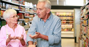Senior couple arguing in the supermarket. In high quality 4k format stock video