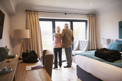 Senior Couple Arriving In Hotel Room On Vacation Royalty Free Stock Photos