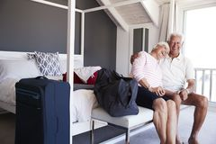 Senior Couple Arriving At Summer Vacation Rental royalty free stock image