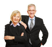 Senior couple as old businesspeople. Smiling senior couple together as old businesspeople team Royalty Free Stock Photos