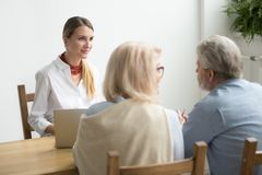 Senior couple asking advice about investment meeting with financ stock images