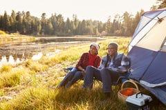 Senior Couple On Autumn Camping Trip Stock Photo