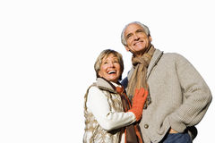 Senior couple in autumn clothes looking up at sky, cut out Royalty Free Stock Photos