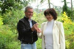 Senior couple in autumn park. Happy senior couple in autumn park Royalty Free Stock Photography
