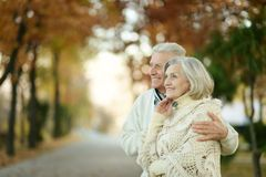 Senior couple in autumn park Royalty Free Stock Photos