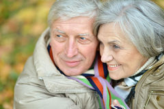 Senior couple in autumn park Stock Photos