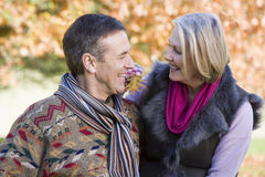 Senior couple on autumn walk. With trees in background Royalty Free Stock Photos