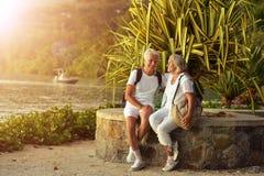 Senior couple with backpacks Stock Photos