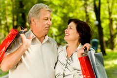 Senior couple with bags Stock Image