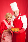 Senior Couple Bakes Together Stock Images
