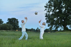 Senior couple with ball Stock Photography
