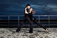 Senior couple ballroom dancing on dark sunset Royalty Free Stock Images