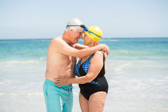 Senior couple with bathing cap at the beach Stock Photography