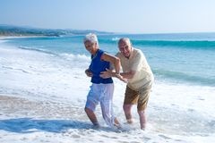 Senior couple at the beach. Senior couple having a good time at the beach Royalty Free Stock Photo