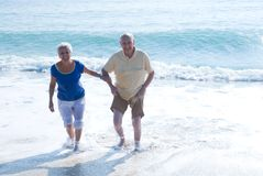 Senior couple at the beach. Senior couple having a good time at the beach Stock Image