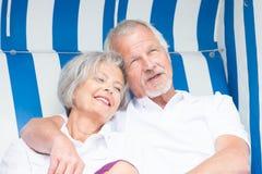 Senior couple in beach chair Stock Photo