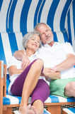 Senior couple in beach chair Stock Image