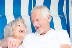 Senior couple in beach chair Royalty Free Stock Photo