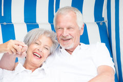 Senior couple in beach chair Stock Photos