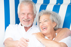 Senior couple in beach chair Stock Photo