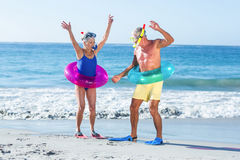 Senior couple with beach equipment Royalty Free Stock Photography