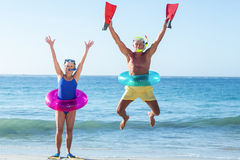 Senior couple with beach equipment Royalty Free Stock Image