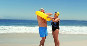 Senior couple at the beach. With fins and inflatable ring stock video