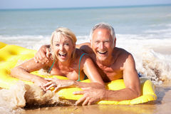 Senior couple on beach holiday Royalty Free Stock Photos