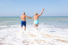 Senior couple on beach holiday Stock Photography