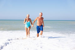 Senior couple on beach holiday stock photos