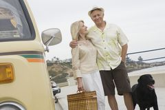 Senior Couple On Beach Promenade With Campervan Stock Photography