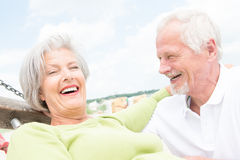 Senior couple at beach Stock Image