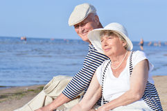Senior couple at the beach. Two elders on a beach near the sea in seaman suits Royalty Free Stock Photo