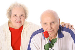 Senior couple with a beautiful rose. Isolated on white Stock Image