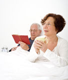Senior couple in bed Royalty Free Stock Photos
