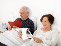 Senior couple in bed Stock Photography