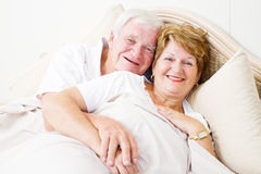 Senior couple in bed Stock Image