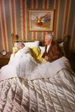 Senior couple in bed Royalty Free Stock Image