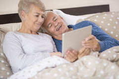 Senior couple in the bed Stock Photography