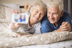 Senior couple in the bed Royalty Free Stock Images