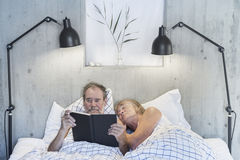 Senior couple in bed Stock Photos