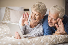 Senior couple in the bed Stock Photos