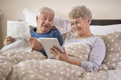 Senior couple in the bed Stock Photo