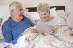 Senior couple in the bed Royalty Free Stock Image