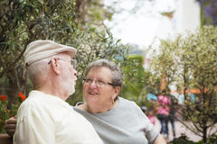 Senior Couple on Bench in the Market Place Royalty Free Stock Images