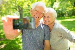 Senior couple taking selfie Stock Photos
