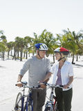 Senior Couple With Bicycles On Tropical Beach Royalty Free Stock Photography
