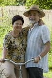 Senior couple bicycling Stock Image