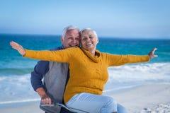 Senior couple with a bike Stock Photos