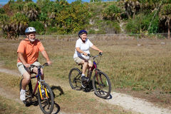 Senior Couple on Bike Ride Stock Photos